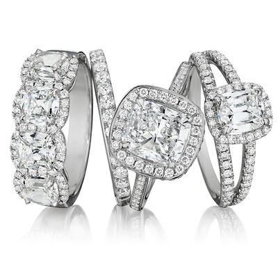 Henri Daussi. Image Featuring Three Diamond Rings in White Gold.