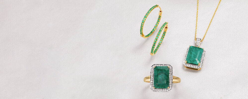 Emerald. Pretty Symbols of Love and Vitality. Image featuring Emerald and  Diamond Ring 885066, Emerald and Diamond Pendant Necklace 888459, Emerald Inside-Outside Hoop Earrings 882931. Click to shop.