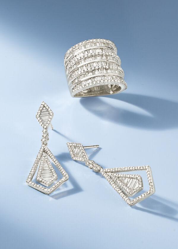 Assorted Diamond Jewelry on a Light Blue Background