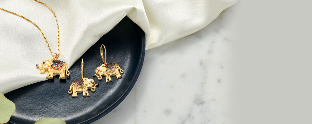 Wild things. Animal jewelry at tame prices. Image Featuring Elephant Earrings and Necklace 932053, 932057