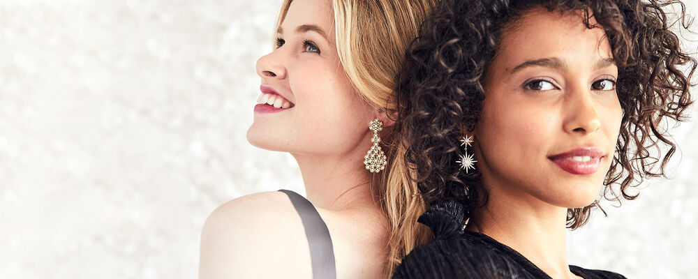 drop earrings elevate your look! two models back-to-back wearing drop earrings