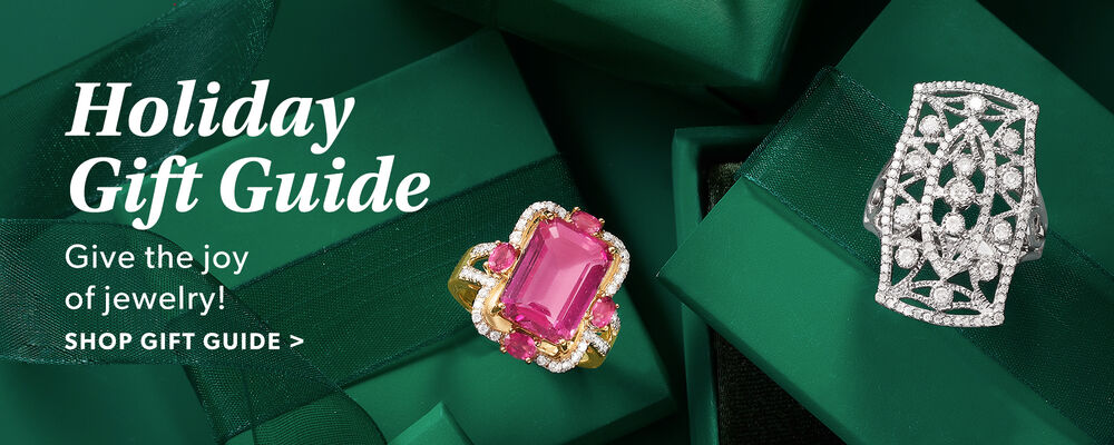Holiday Gift Guide. Give The Joy of Jewelry! Shop Gift Guide. Image Featuring Two Rings on Green Background