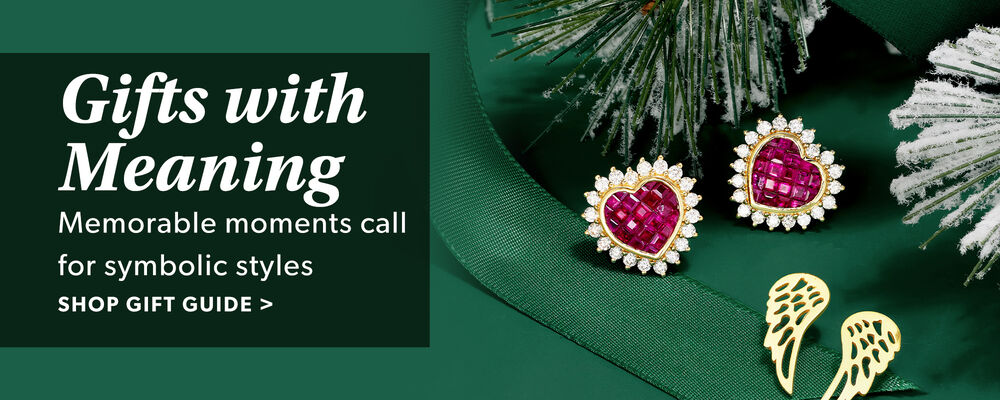 Gift With Meaning. Memorable Moments Call For Symbolic Styles. Shop Gift Guide. Image Featuring Two Sets of Earrings on Green Background With Snow And Greens