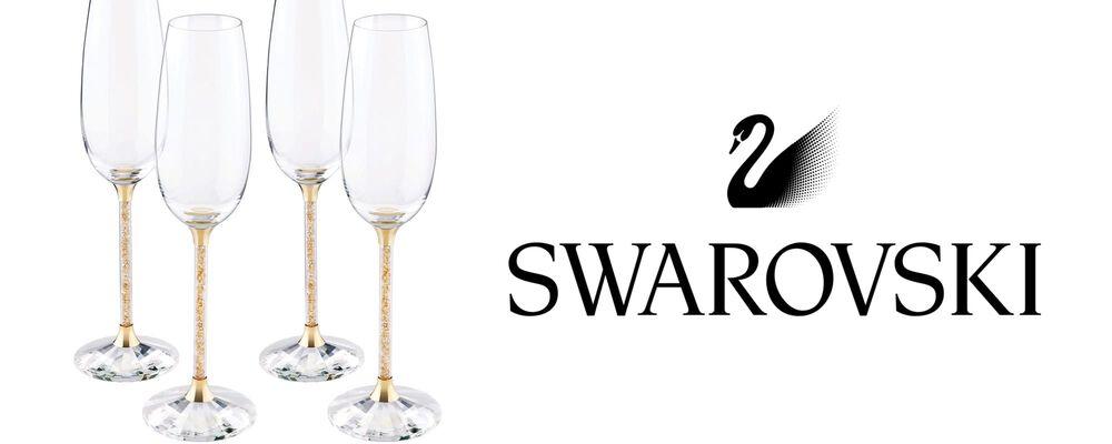 Swarovski. Image of logo and four wine glasses.
