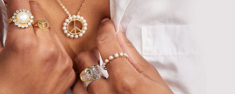 Iconic Symbols. Express Yourself With Beloved Emblems. Image Featuring Model Wearing Rings and Necklace with Symbols
