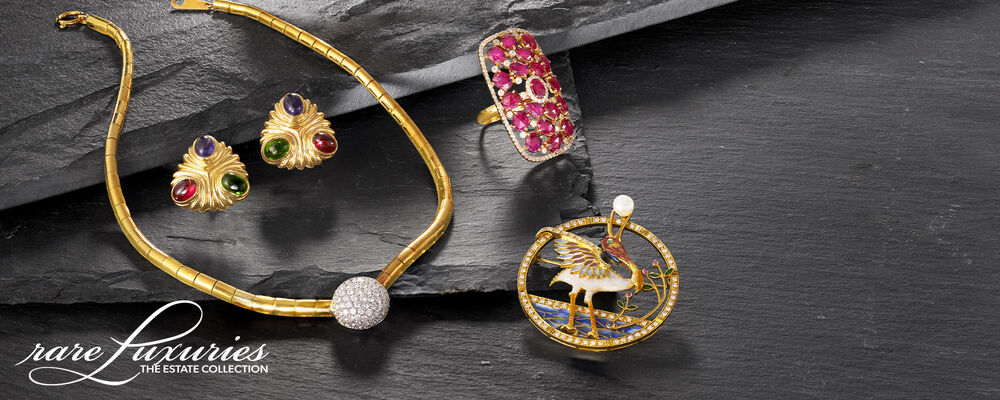 Estate. One-of-a-kind Treasurers. Image Featuring An Assortment of Estate Jewelry on Brown Background