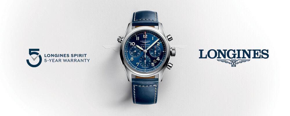 Longines. Image of silver Longines watch.