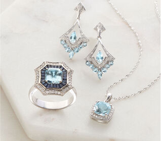 Something Blue. A tradition to treasure. Image of blue gemstone ring, earrings and pendant.