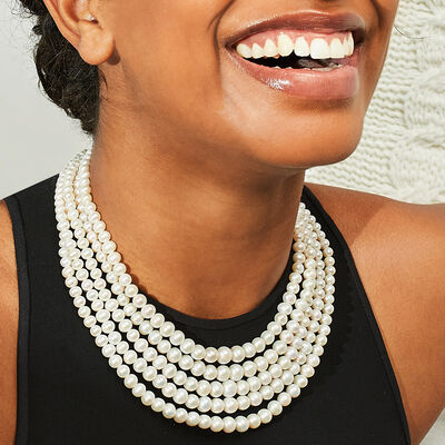 Traditional and timeless styles. Shop Classic Pearls. Model Wearing A Multi-Strand Pearl Necklace