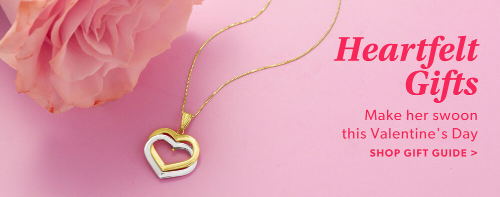 Heartfelt Gifts. Make Here Swoon This Valentine's Day. Shop The Gift Guide. Image Featuring Heart Pendant Necklaces on Pink Background With Pink Flower