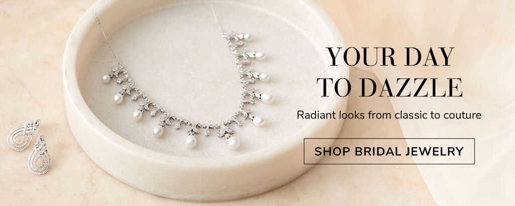 Your day to dazzle. Radiant looks from classic to couture. Shop bridal jewelry. Image of diamond earrings and pearl necklace.