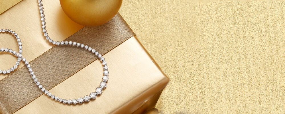 classics forever fashionable. image featuring diamond necklace on holiday present background