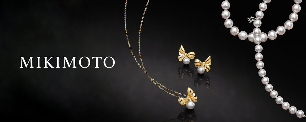 Mikimoto. Image shows gold and pearl necklace and earrings and a pearl strand necklace.