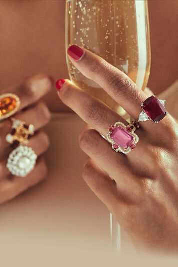 VIP Rewards Club. Model wearing Byzantine gold earrings, bracelet and ring