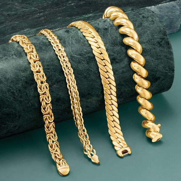 Glimmering gold bracelets.