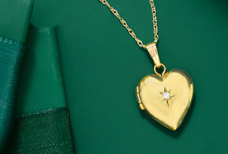 For Tiny tots. Image Featuring Gold Pendant Necklace on Green Background.