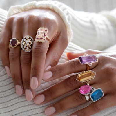 Collect every standout style. Shop Cocktail Rings. Image Featuring Model Wearing Gemstone Rings