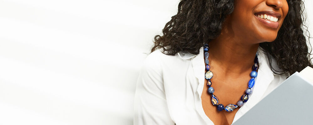 Necklaces. Drape yourself in fabulous finds. Image Featuring Model Wearing Glass Bead Necklace