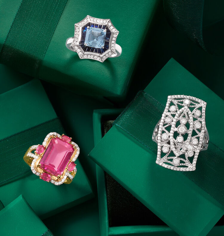 Merry Must-Haves For A Holly Jolly Holiday. Shop Party Looks. Image Featuring 2 Gemstone Rings and a Diamond Ring on Green Background