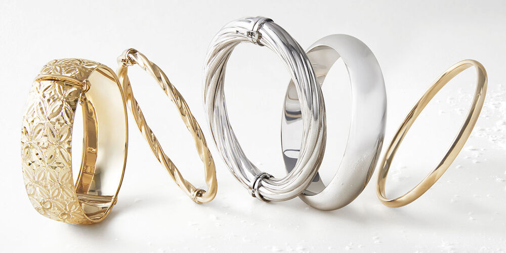 Different Metal Jewelry Finishes on Five Bracelets