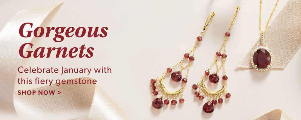 Gorgeous Garnets. Celebrate January With This Fiery Gemstone. Shop Now. Image Featuring Garnet Earrings and Necklace on Pink Background With Ribbons