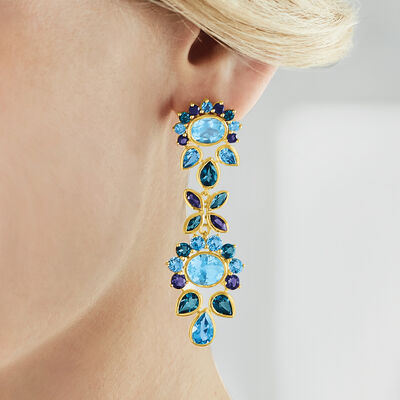 Stand out in statement earrings. Shop Now. Image Featuring