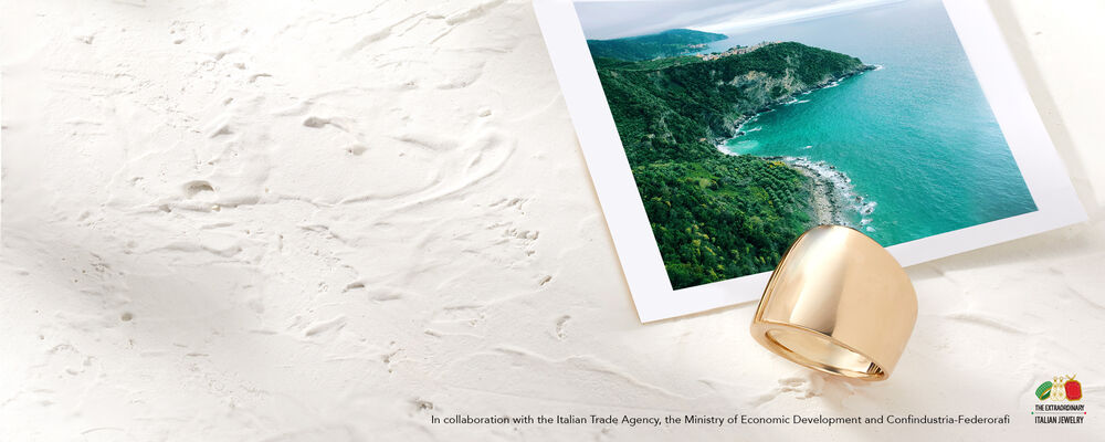 Direct From Italy With Love. The Extraordinary Italian Jewelry. In collaboration with the Italian Trade Agency, the Ministry of Econimic Development and Confindustrua-Federorafi. Image shows photo of Italian coastline and gold ring.