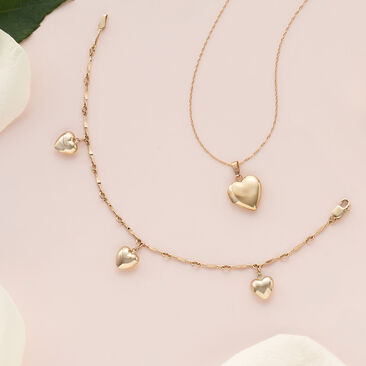 The Little Charmers. Pretty picks for the flower girl. Image of children's heart necklace and bracelet.'