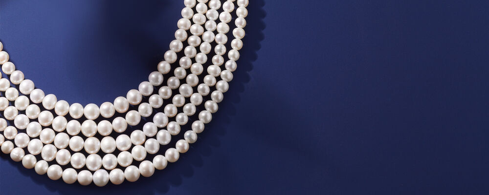 pearls. Gifts From The Sea. Image Featuring Pearl Necklace on Blue Background