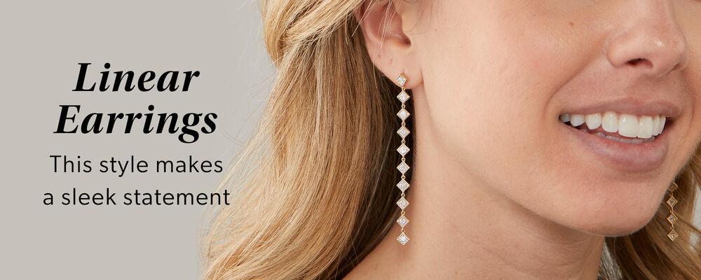 Linear Earrings -- This style makes a sleek statement. Model wearing linear earrings.