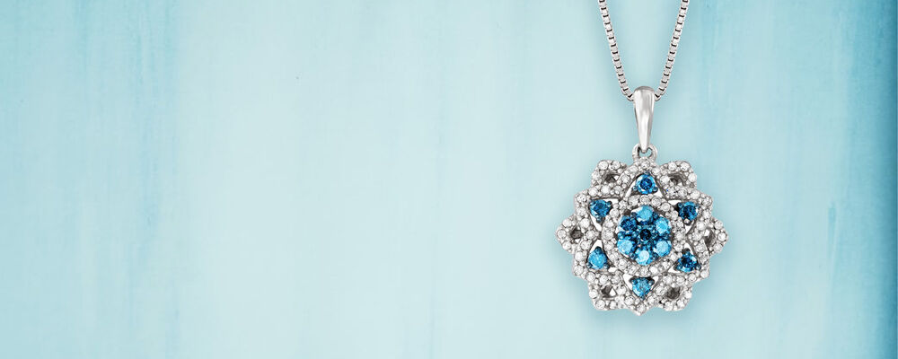 Color & Sparkle. Brilliant Diamonds in Beautiful Bold Hues. Image featuring Blue and White Diamond Flower Pendant Necklace in Sterling Silver 934260