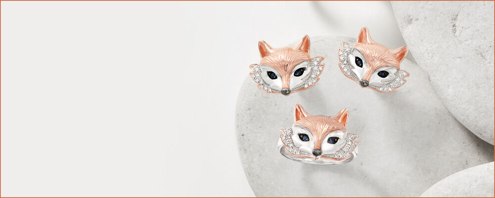 fox jewelry - a pair of fox face earrings with sapphire eyes and diamond accents, and a ring to match. set in two-tone sterling silver