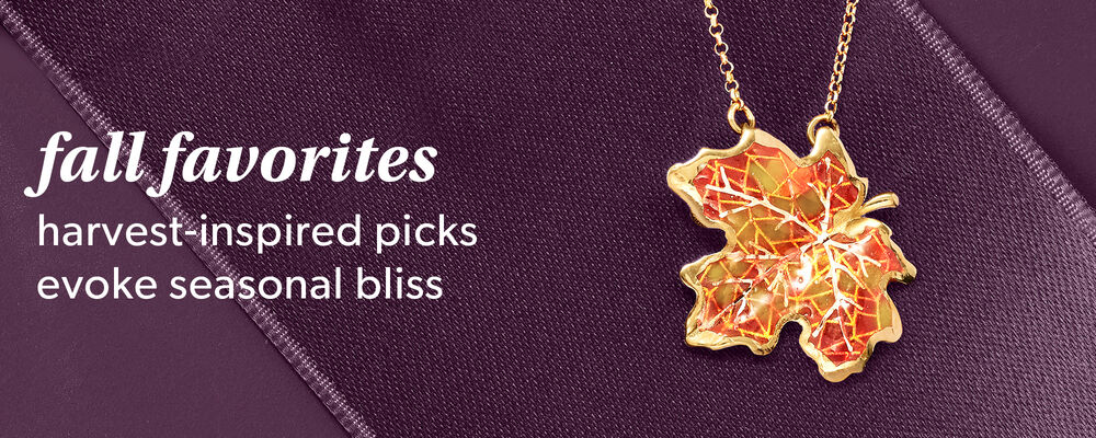 Fall Favorites. harvest-inspired picks evoke seasonal bliss. image of orange-hued leaf necklace on purple background.