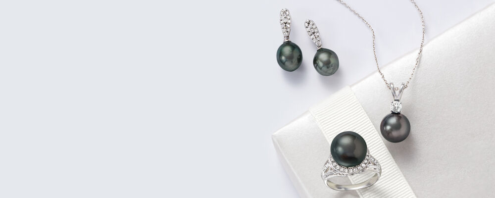 tahitian pearls an alluring accessory. image featuring assorted tahitian pearl jewelry on white background