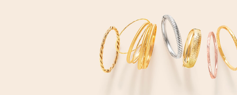 Bangles. Stacking Is A Major Must! Image featuring Italian 18kt Gold Over Sterling Silver Jewelry Set: Seven Bangle Bracelets 869467, Italian Tri-Colored Sterling Jewelry Set: Three Square-Edge Hammered Bangle Bracelets 901368, Sterling Silver Spiraled Oval Bangle Bracelet 881396, and 14kt Yellow Gold Twisted Bangle Bracelet 910480. Click to shop