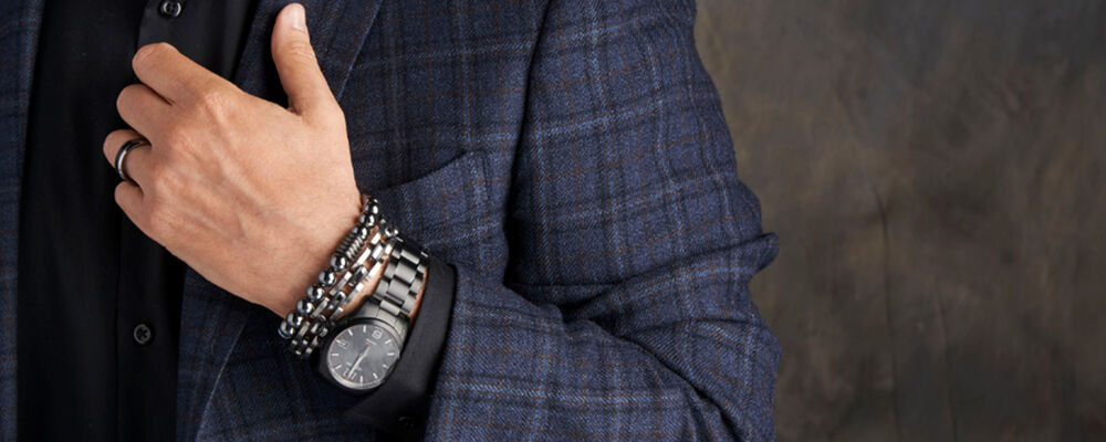 Men's Jewelry. Image featuring Men's Stainless Steel Link Bracelet with Black Rubber 901321, Men's Black Sapphire Eternity Wedding Ring 880484, Longines Conquest V.H.P. Men's 43mm Watch  CQVV01. Click to shop.