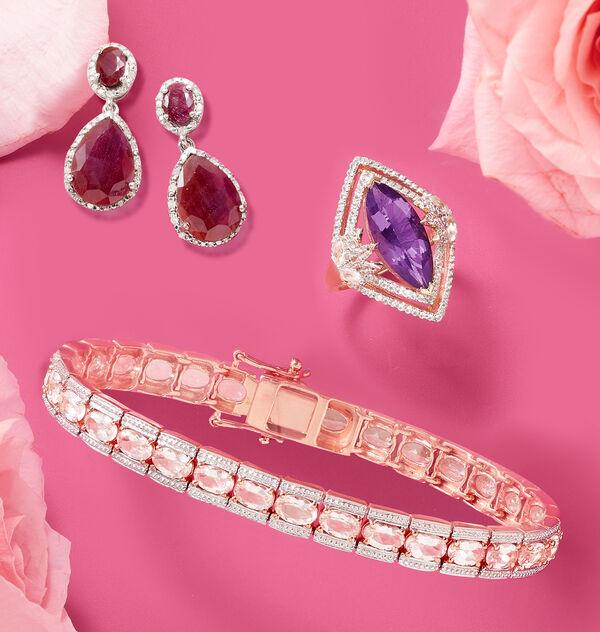 red drop earrings, purple cocktail ring, and morganite line bracelet