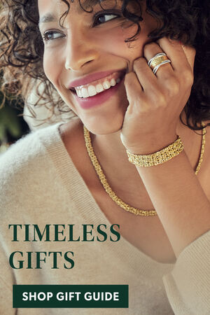 Timeless Gifts. Shop Gift Guide. Image Featuring Model Wearing Gold Jewelry