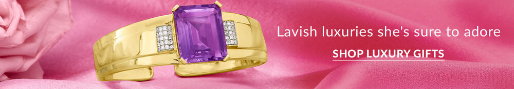 lavish luxuries she's sure to adore. shop luxury gifts. background image features gold bangle with amethyst stone