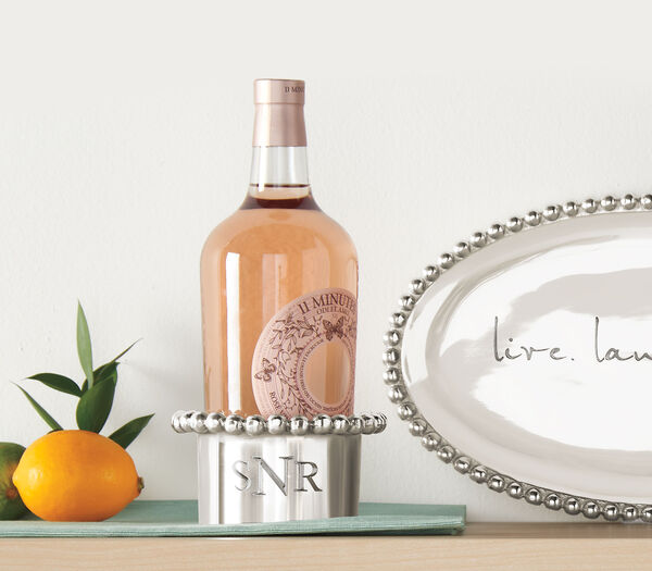 A Personal Touch. Signature styles for any decor. Image of wine holder, wine bottle and platter.