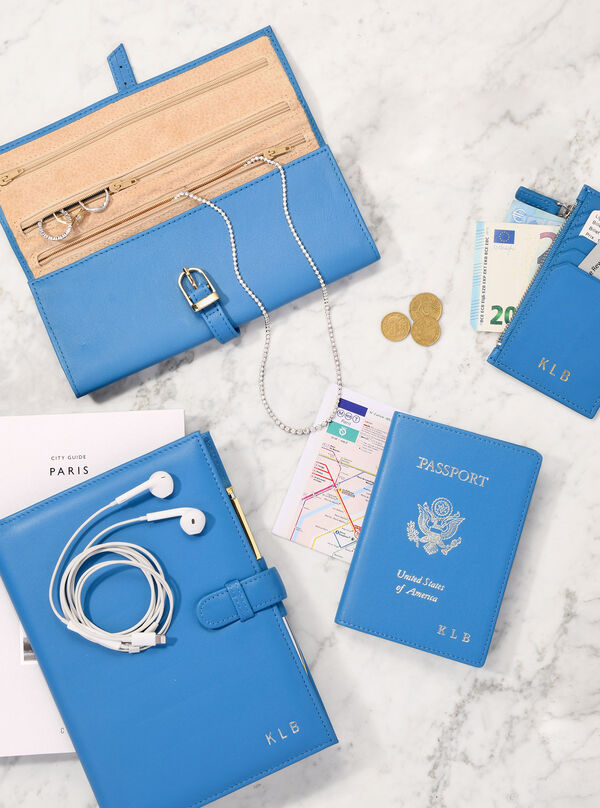 On-the-Go Accessories. Must-haves to take with you wherever you go. Image of passport, notebook and jewelry case.