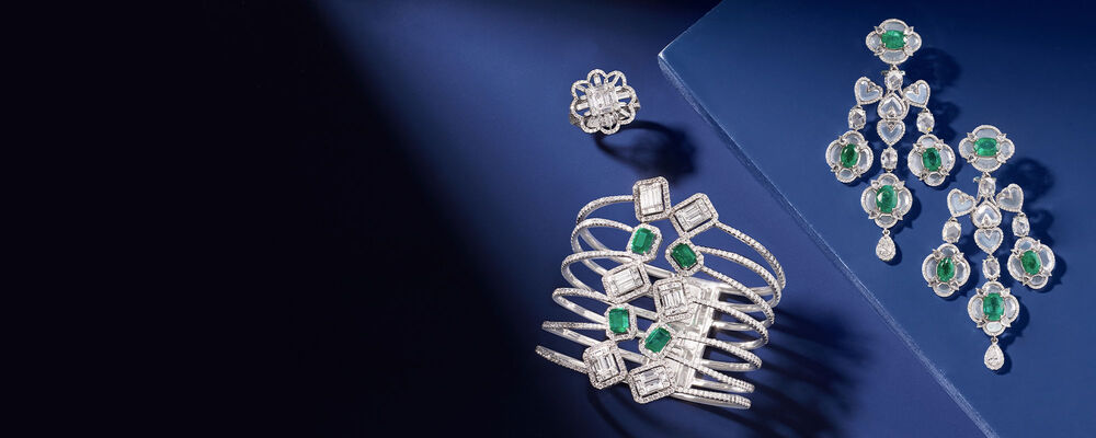 Enter the Vault. Our Most Luxurious Fine Jewelry. Image Featuring Assorted Jewelry on Blue Background