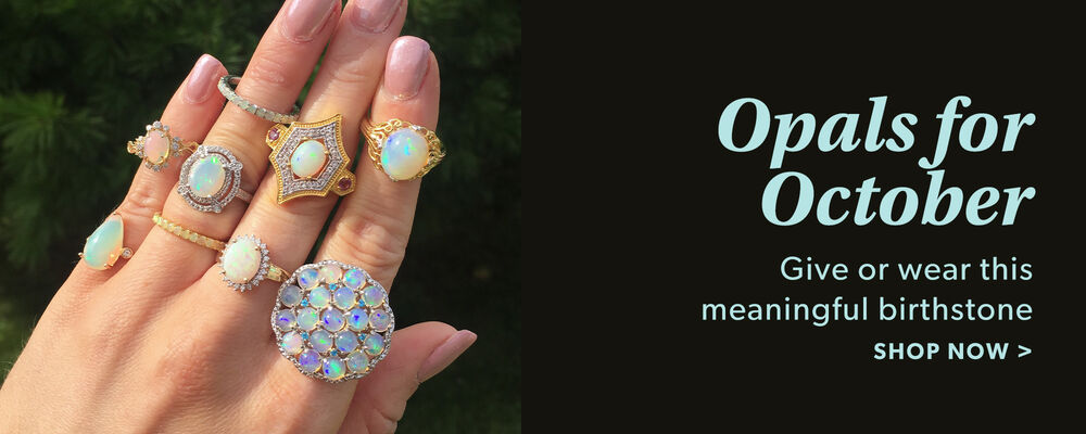 Opal For October. Give or Wear This Meaningful Birthstone. Shop Now. Image Fearing a Model's Hand with 6 Opal Rings