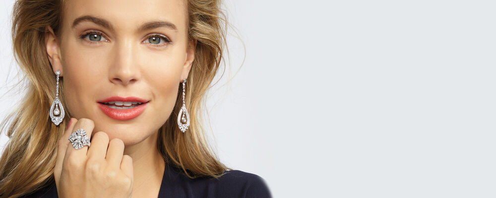 Diamonds. Treat Yourself To Brillance. Image Featuring Model Wearing Diamond Earrings and Ring 924912, 924845