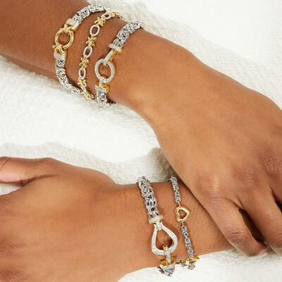 Alluring designs for your wrist. Shop Silver Bracelets. Image Featuring Model Wearing Many Different Kinds of Bracelets