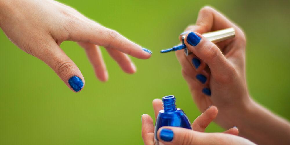 Applying Blue Nail Polish. Photo by Engin Akyurt on Unsplash.com