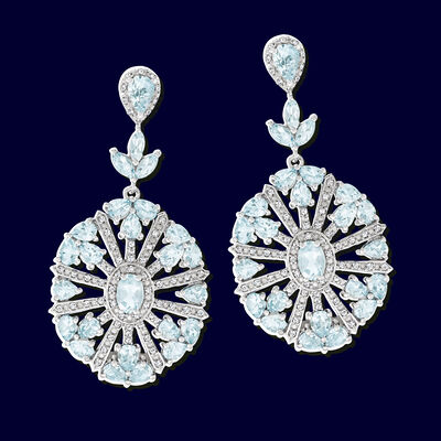 Gemstone & Diamond Drop Earrings on Dark Blue Background