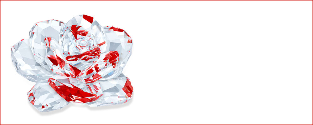 crystal multi-faceted rose figurine shining with red reflections