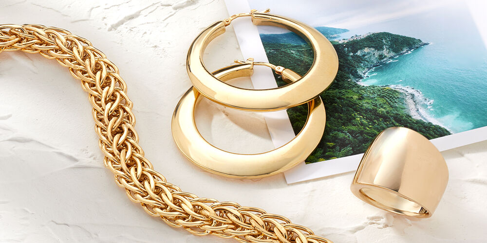 Italian Gold Necklace, Earrings and Ring on Photo of Italian Coastline