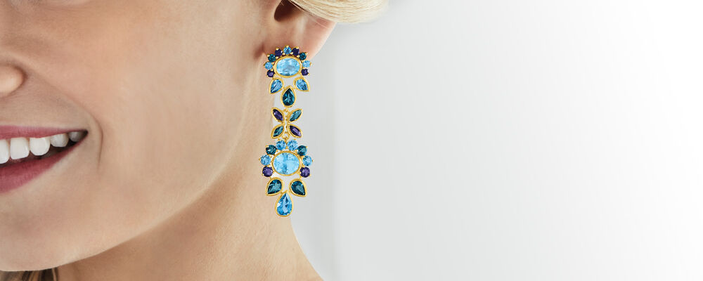statement earrings stand out in wow-worthy pairs. Image featuring